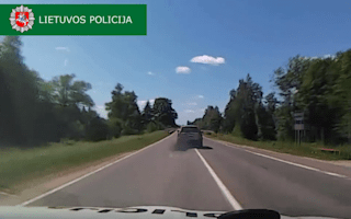 Driver uses car's exhaust as smokescreen in Lithuania