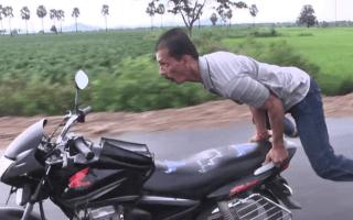 Biker practises yoga on the move