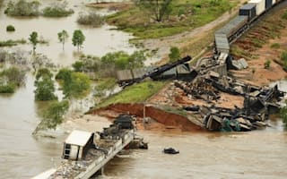Train derails and bridge collapses after flooding in Australia
