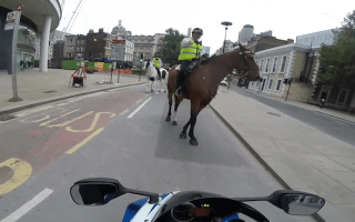 Reckless biker gets put in his place by mounted cop