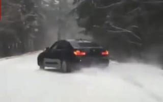 BMW driver scares oncoming motorist off snowy road