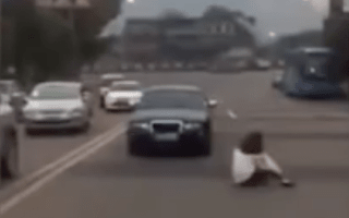 Angry motorist nearly run over by her own car