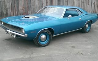 A 1970 Plymouth Barracuda has sold on eBay for almost £200,000