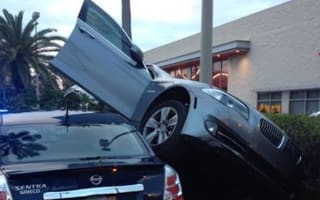 Man claims BMW Park Assist function caused him to 'mount' parked car
