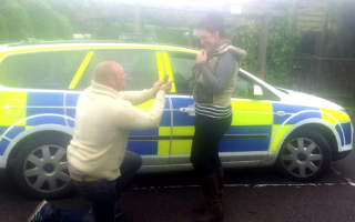 Man proposes to girlfriend in back of police car
