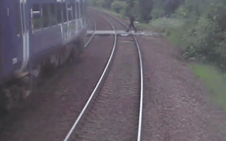 Cyclist in near-miss with train at level crossing