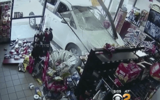 Shocking footage shows car crash into shop and hit customer