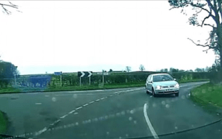 Out of control Volkswagen narrowly avoids crash