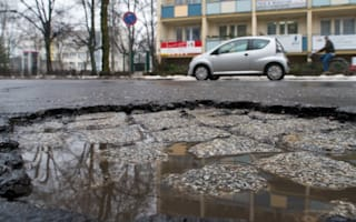 Car written off as 4m wide pothole consumes front wheel