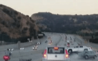 Biker causes terrifying freeway crash during fit of road rage