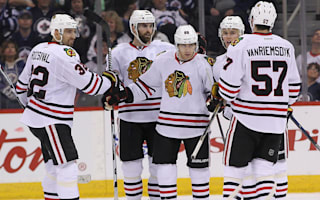 Blackhawks return to form, Caps win