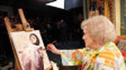 Betty White is restoring a painting on