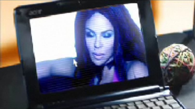 "Screen Grabs: Lil' Kim ""Download"" video features sampling of Acer products, samples Zapp"