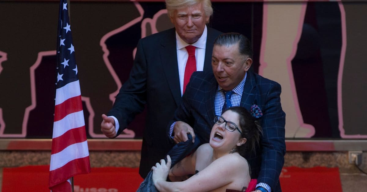 Topless Protester In Spain Grabs Waxwork Donald Trump's Crotch