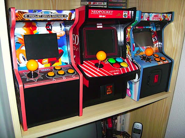 Neo Geo mini-arcade consoles fit on a bookshelf, set our hearts a-flutter