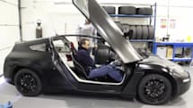 Delta E4 electric coupe goes out for a spin, carrying lucky humanoid (video)