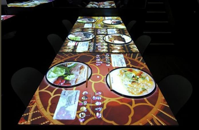 London restaurant claims fame with touch-sensitive tables, colorful menu projectors