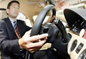 Hitachi shows off finger-controlled steering wheel