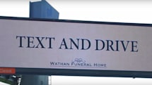 Billboard for fake funeral home urges drivers to text