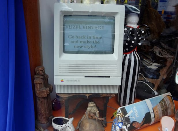A Mac SE becomes a store sign