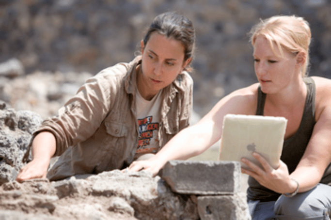 Archeologists brave flinging bits of rock with the iPad