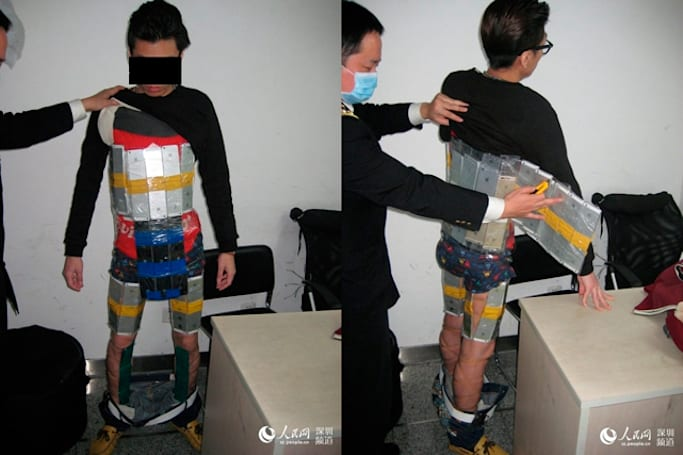 This guy tried to smuggle 94 iPhones using only his body