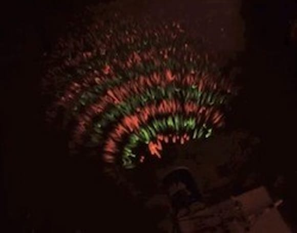Man illuminates electromagnetic waves using coffee cans and LEDs, Christmas-colored science ensues
