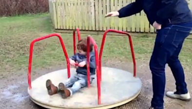 Little Boy Flung Off Playground Carousel