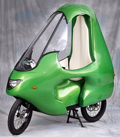 Enclosed electric motorcycle is green and ghastly