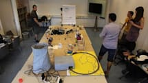 Pile of Arduinos hooked up in Rube Goldberg-esque chain reaction (video)