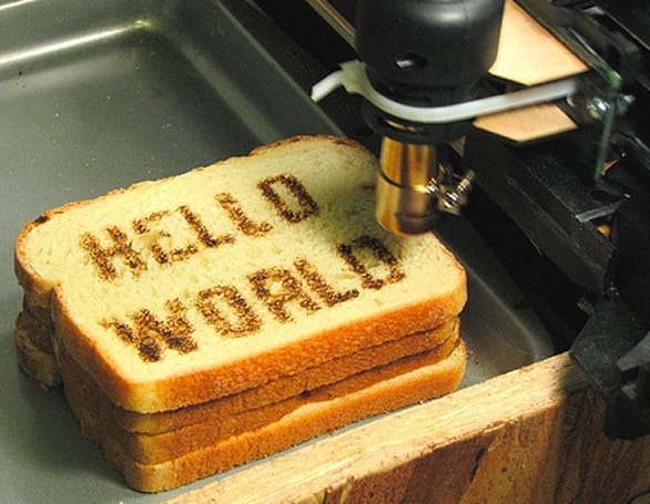 CNC hot-air gun used to draw faces, text on toast