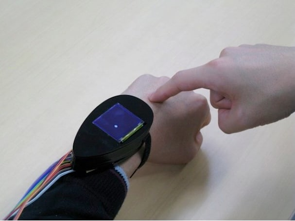 Wrist sensor turns the back of your hand into a meaty haptic interface (video)