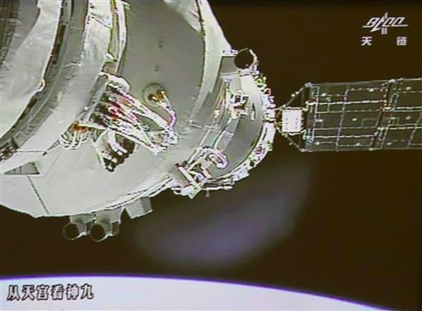 Chinese astronauts go hands-on, manually dock with orbiting module