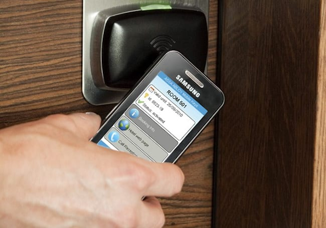 ASSA ABLOY trials remote hotel check-ins, unlocking your room with NFC cellphones (video)