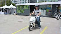 Riding the battery-powered Gogoro smart scooter