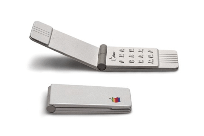 An Apple flip phone from 1984 and a tablet from 1979
