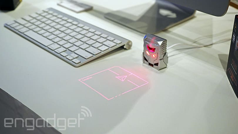 This tiny robot head replaces your mouse with a laser-projected one
