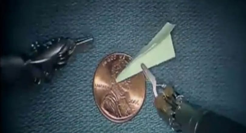 Surgical robot builds tiny paper airplane (video)
