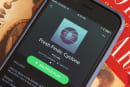 Spotify agrees to pay millions for unmatched royalties