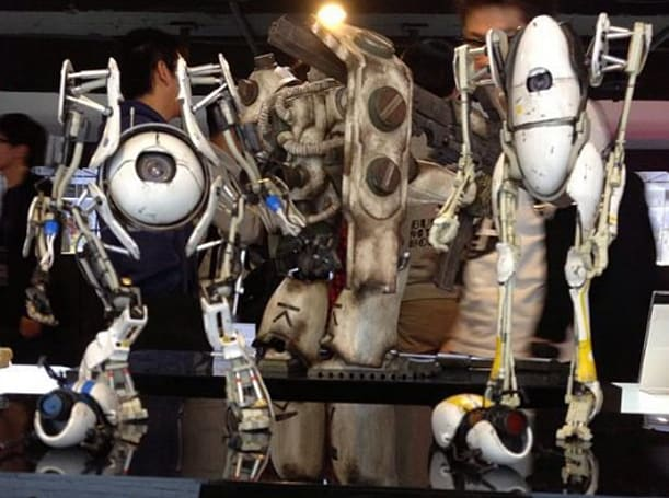 Portal 2's Atlas and P-Body get fresh, filthy coats of paint from ThreeA