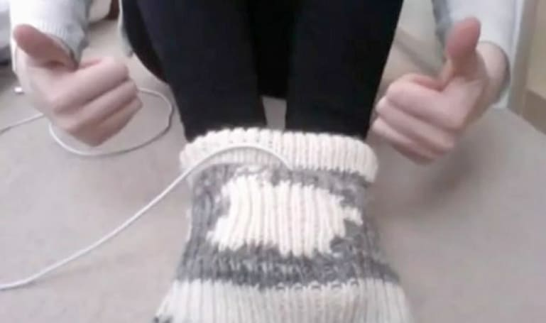 """Sockintosh"" power adapter foot cozy keeps your feet warm, might light you on fire"