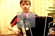 This young man is very serious about the Mortal Kombat theme, as well as the accordion
