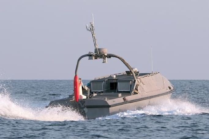 A minesweeping robot boat will protect the Navy's expensive new baby