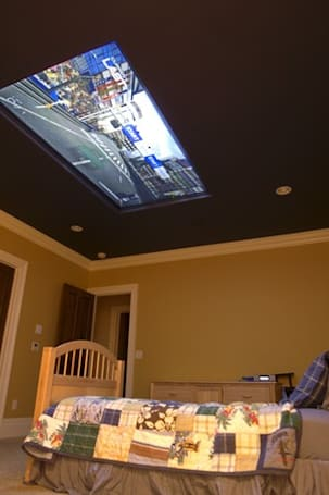 Mom installs 98-inch screen in son's bedroom ceiling, deservedly garners award nomination