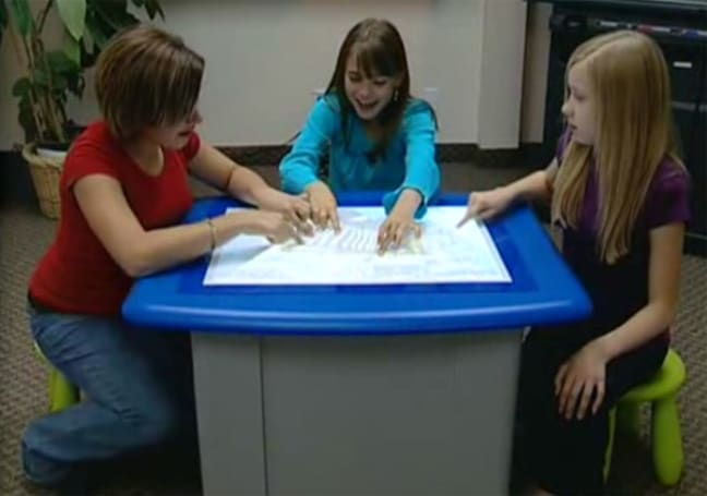 SMART pulls the cloth off multitouch table for school kids