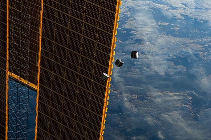 Visualized: Cubesat micro-orbiters slip into space to flash Earth in Morse code
