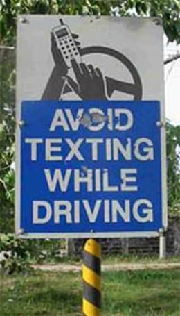 States mulling bans on driving while texting