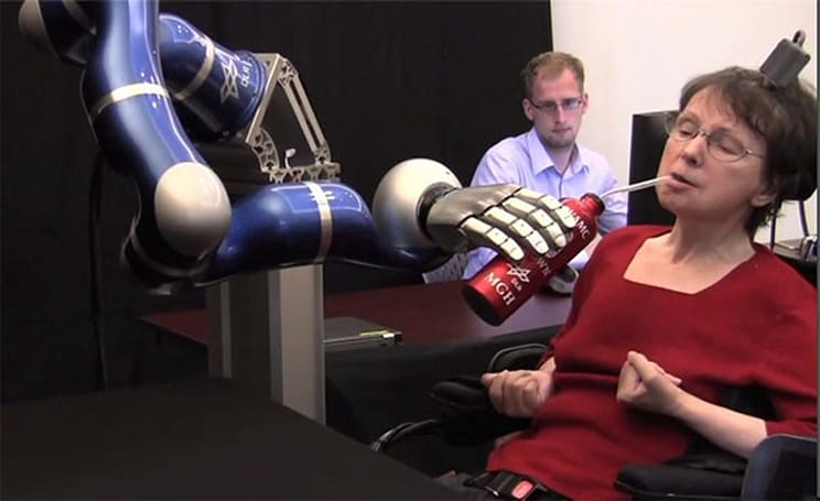 Mind-operated robot arm helps paralyzed woman have her cup o' joe (video)
