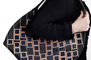 Diffus Solar Handbag charges your cell during the day, may actually leave the closet