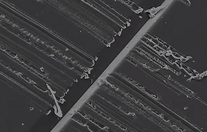 Ruined vinyl under a microscope makes for a beautiful music video